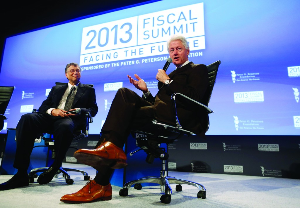 Former President Bill Clinton and Microsoft founder Bill Gates on Tuesday speak about debt at the 2013 Fiscal Summit in Washington. (AP Photo/Charles Dharapak)