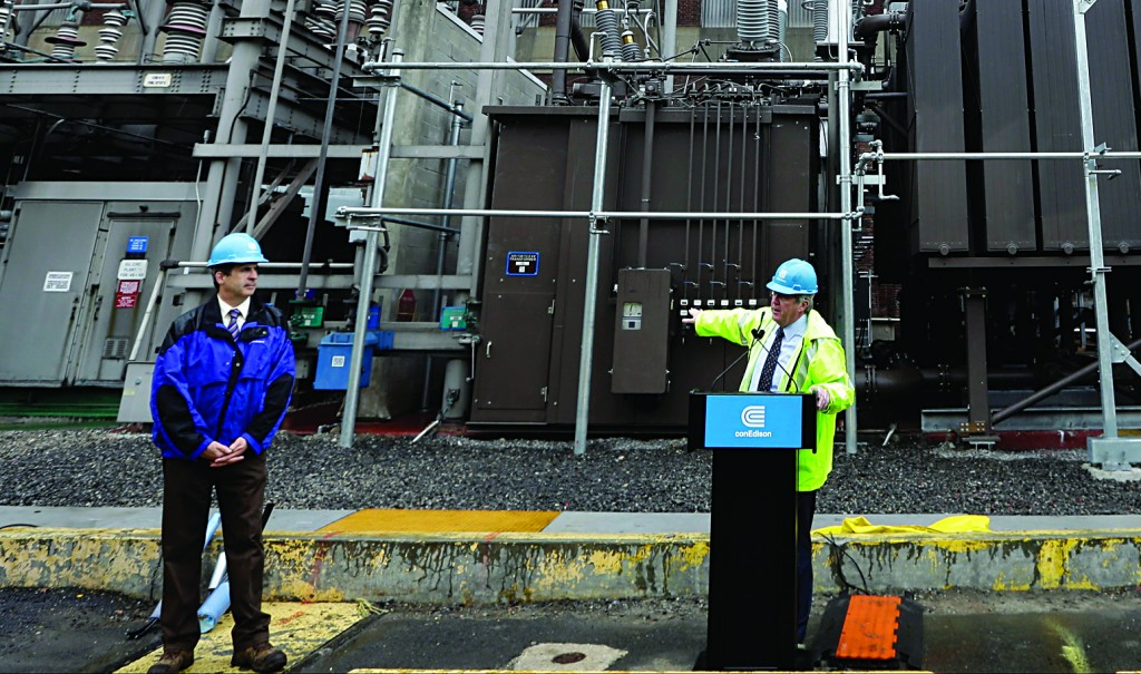 Con Edison's Chairman and CEO, Kevin Burke (C), speaks during a news  conference Tuesday at the Mill Yard Substation in New York.(AP Photo/Frank Franklin II)
