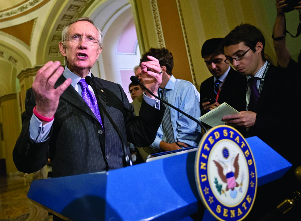 Senate Majority Leader Harry Reid of Nevada gestures as he speaks with reporters about immigration reform, intelligence leaks and other issues following a Democratic strategy session on Tuesday, on Capitol Hill in Washington. (AP Photo/J. Scott Applewhite)