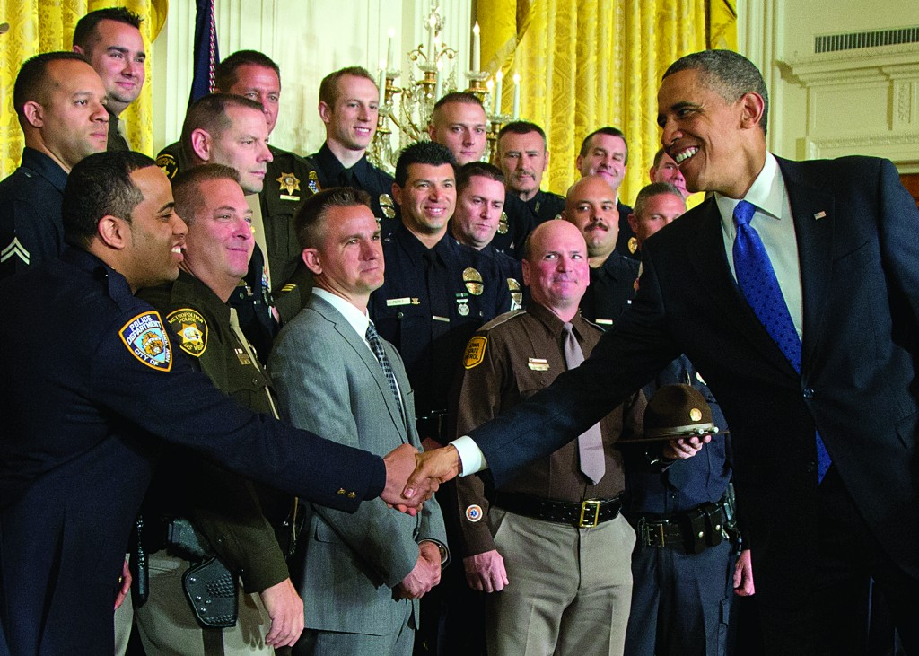 President Barack Obama shakes hands with New York Police Detective Ivan Marcano  during a White House  ceremony Saturday. (AP Photo/Carolyn Kaster)