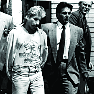 Detective Louis Scarcella (right) with Rabbi Chatzkel Wertzberger murder suspect David Ranta going into Central Booking in 1990.