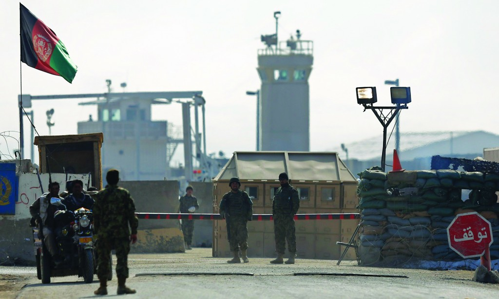 Afghan National Army (ANA) soldiers stand at the Bagram detainee center gate north of Kabul. (REUTERS/Maxim Shemetov)