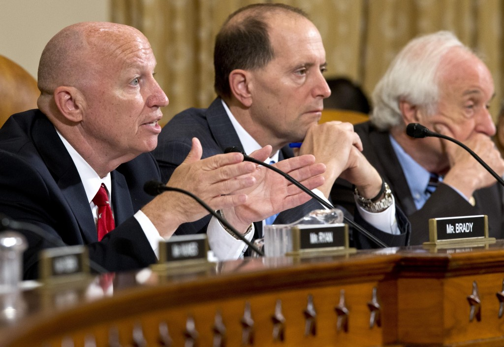 House Ways and Means Committee member, Rep. Kevin Brady, (R-Texas), left, accompanied by committee chairman, Rep. Dave Camp , (R-Mich.), center, and the committee's ranking Democrat, Rep. Sander Levin, (D-Mich.), right, speaks on Capitol Hill in Washington, Friday, May 17, during the committee's hearing on the extra scrutiny the Internal Revenue Service gave Tea Party and other conservative groups that applied for tax-exempt status. (AP Photo/J. Scott Applewhite)