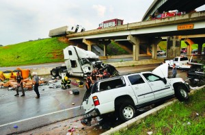 A tornado caused extensive damage along Interstate 40 in Shawnee, Okla., Sunday evening. (AP Photo/The Oklahoman, Jim Beckel)