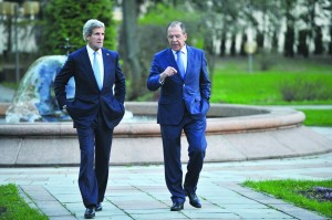 Russian Foreign Minister Sergey Lavrov, right, and U.S. Secretary of State John Kerry speak while taking a walk in the garden of the Foreign Ministry mansion in Moscow, Russia, Tuesday. (AP Photo/Mladen Antonov, Pool)