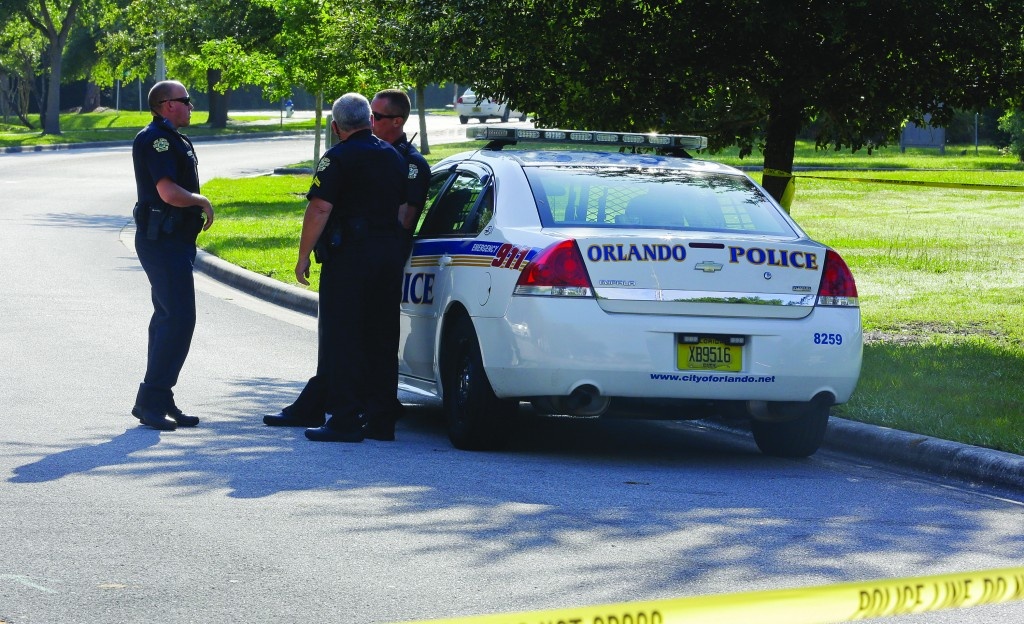 Police officers block the entrance to an apartment complex where man was fatally shot, Wednesday, in Orlando, Fla. The FBI says the man, being questioned by authorities in the Boston bombing probe, was fatally shot when he initiated a violent confrontation. (AP Photo/John Raoux)