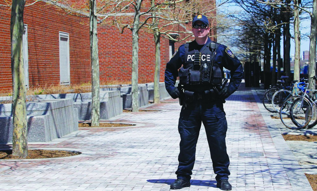 A police officer stands guard outside of John Joseph Moakley United States Courthouse in Boston, Massachusetts, Wednesday. (REUTERS/Jessica Rinaldi)