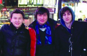 This undated photo shows, L-R, Azamat Tazhayakov and Dias Kadyrbayev, from Kazakhstan, with Boston Marathon bombing suspect Dzhokhar Tsarnaev in Times Square in New York. Kadyrbayev and Tazhayakov, two college buddies of Tsarnaev, were jailed by immigration authorities the day after Tsarnaev's capture. (AP Photo/VK)