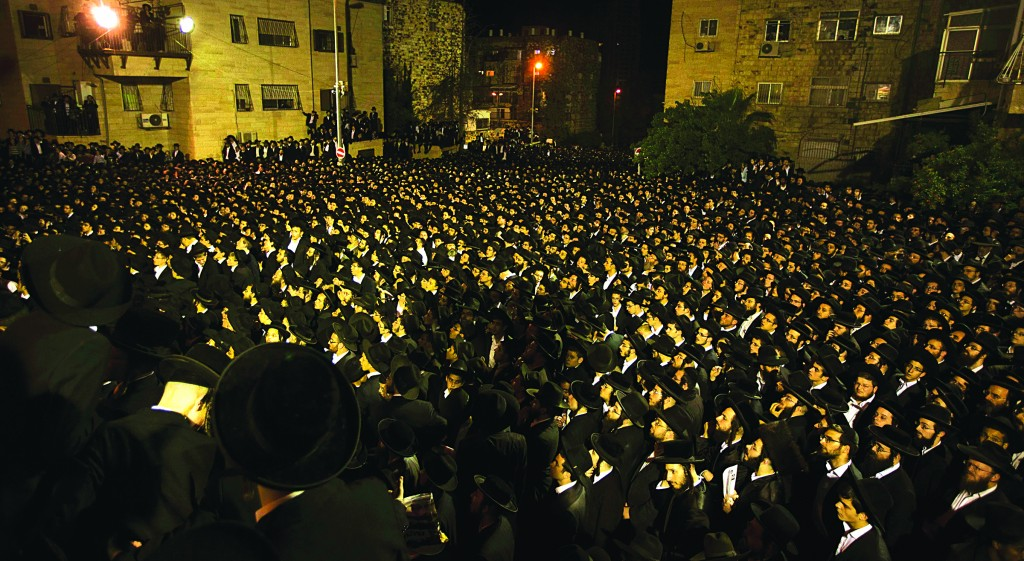 Thousands protested government plans for the drafting of yeshivah students outside the IDF recruiting office on Rashi St. on Thursday. (REUTERS/Ronen Zvulun)