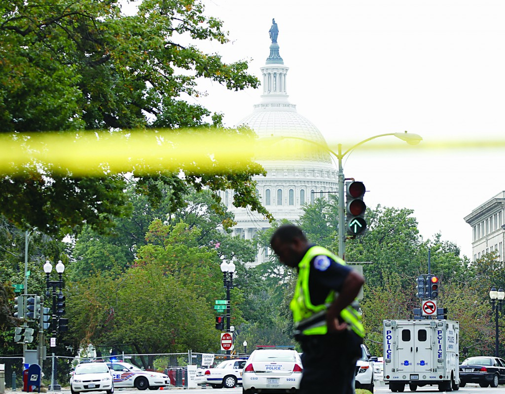 Police respond to a shooting on Capitol Hill in Washington, Thursday.  (AP Photo/Molly Riley)