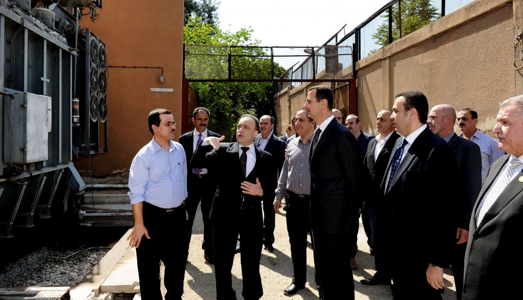 President Bashar Assad visits the Umayyad Electrical Station on May Day, Wednesday, a day after a powerful bomb hit the capital. in Damascus, Syria.(AP Photo/SANA)