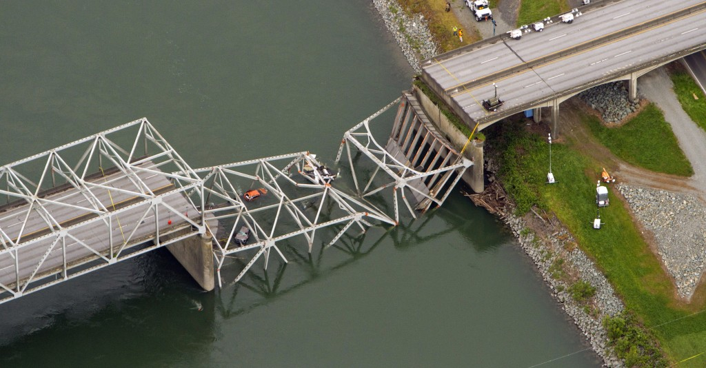 In this Friday, May 24, 2013 photo, a collapsed section of the Interstate 5 bridge over the Skagit River is seen in an aerial view over Mount Vernon, Wash. (AP Photo/The Seattle Times, Mike Siegel)