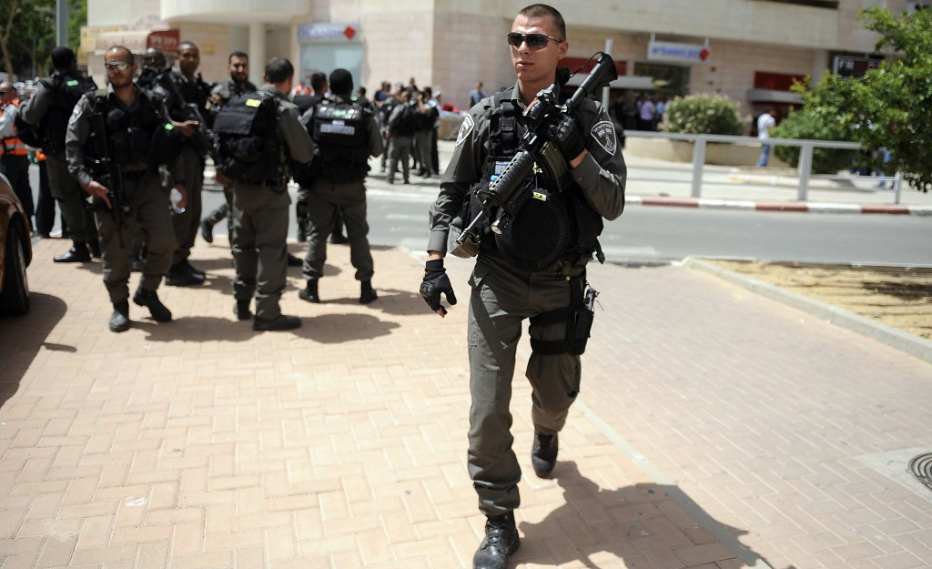 Israeli security forces are seen following a shooting incident at a bank in Beersheva on Monday. (Flash90)