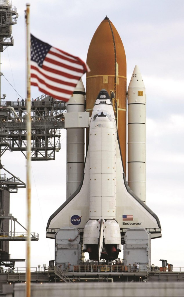 Space shuttle Endeavour rests on the launch pad ready for launch. (AP Photo/John Raoux)