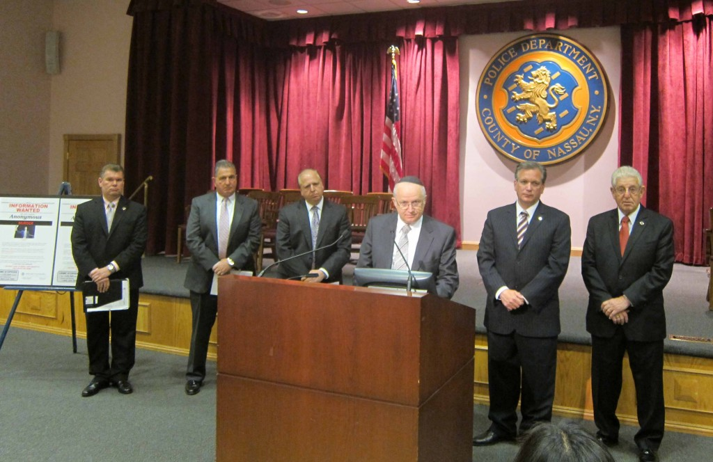 (L-R) Lt. John Azzata, commanding officer, Nassau County Police Homicide Squad, County Police Chief of Detectives John Capece, Anshel Weiss at the podium, County Executive Edward Mangano, Police Chaplain Barry Dov Schwartz.(POLICE PHOTOGRAPHER DORIS RYAN)