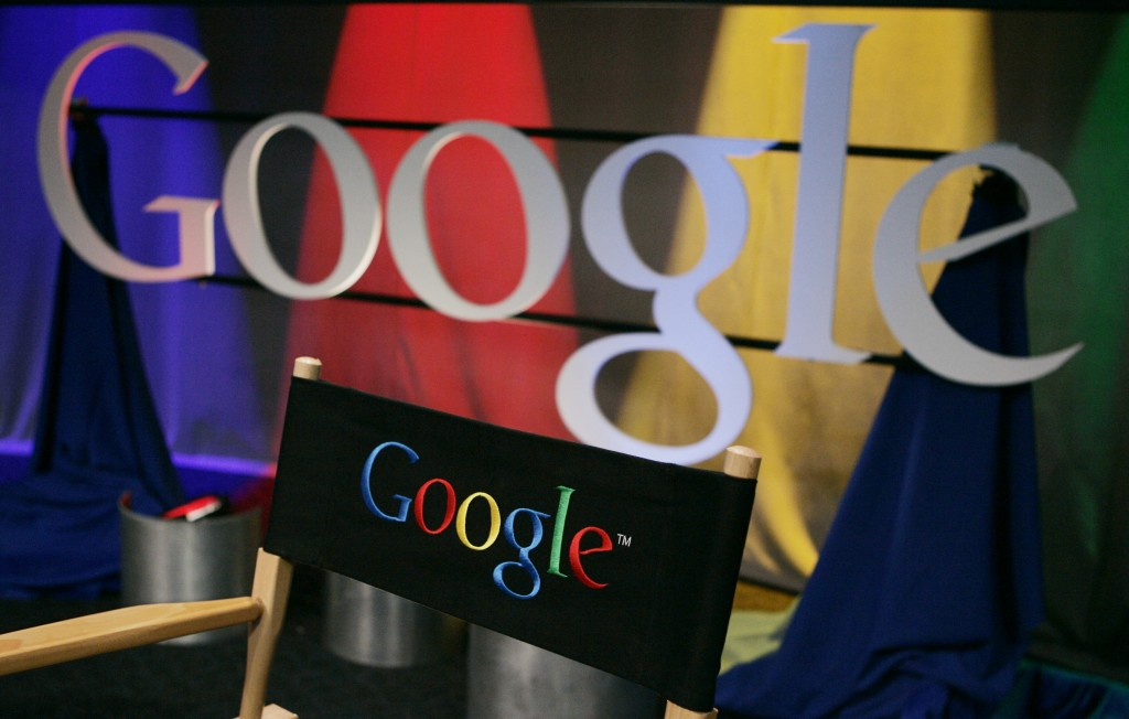 FILE - In this May 30, 2007 file photo, a Google sign is seen inside Google headquarters in Mountain View, Calif. Google is buying online mapping service Waze in a deal that keeps a potentially valuable tool away from its rivals while gaining technology that could improve the accuracy and usefulness of its own popular navigation system, the company announced Tuesday, June 11, 2013. (AP Photo/Paul Sakuma, File)
