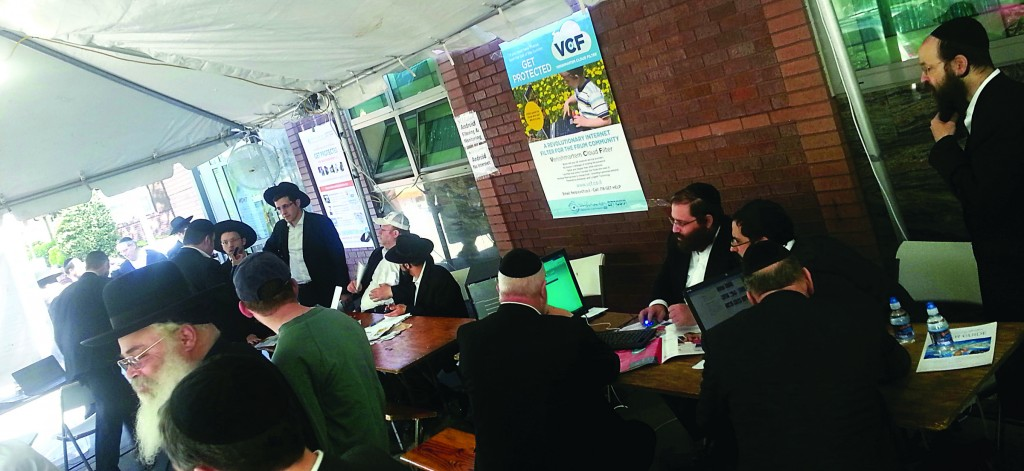 "At a Flatbush ""Filterthon"" event in a tent set up in front of Khal Veretzky (Landau's shul), more than 20 technicians installed filters and answered technology questions for hundreds of residents at no charge, all day Sunday. The event was organized by Venishmartem."