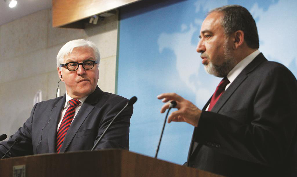 Israel's Minister of Foreign Affairs Avigdor Lieberman (R) holds a press conference recently with his German countrpart Frank-Walter Steinmeier.(Miriam Alster/FLASH90)