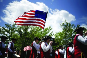 A fife and drum band participates in the College Point Memorial Day Parade in New York Sunday.(AP Photo/Seth Wenig)