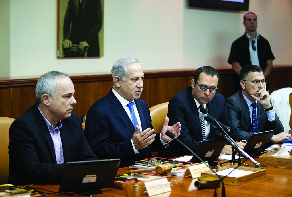 Israel's Prime Minister Binyamin Netanyahu speaks during the weekly cabinet meeting in which said he was restoring a billion shekels to the defense budget. (REUTERS)
