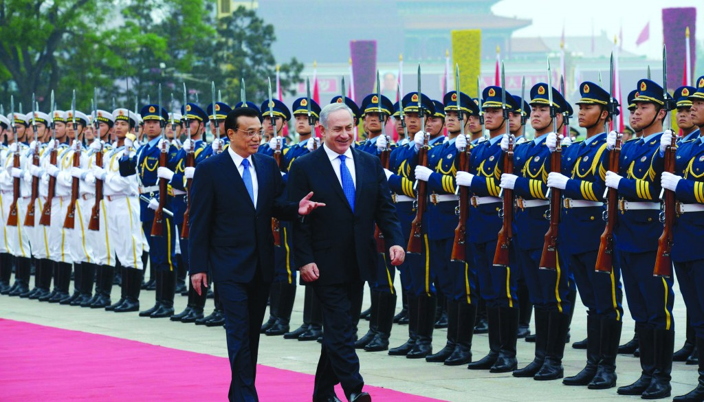 Prime Minister of Israel Binyamin Netanyahu reviewing an honor guard at the Great Hall of the People in Beijing on Wednesday. (FLASH90)