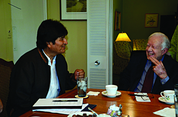 Bolivian President Evo Morales talks with former President Jimmy Carter at the latter's Atlanta home Monday. (Nam News Network)