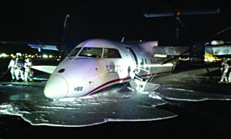 A US Airways commuter plane is doused with foam after an emergency landing at Newark Airport. (AP Photo/WABC)