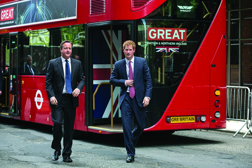 Britain's Prince Harry (R) and British Prime Minister David Cameron (L) arrive on a double-decker bus to attend the event to promote British trade and tourism in New York Tuesday. (AP Photo/Brendan McDermid)