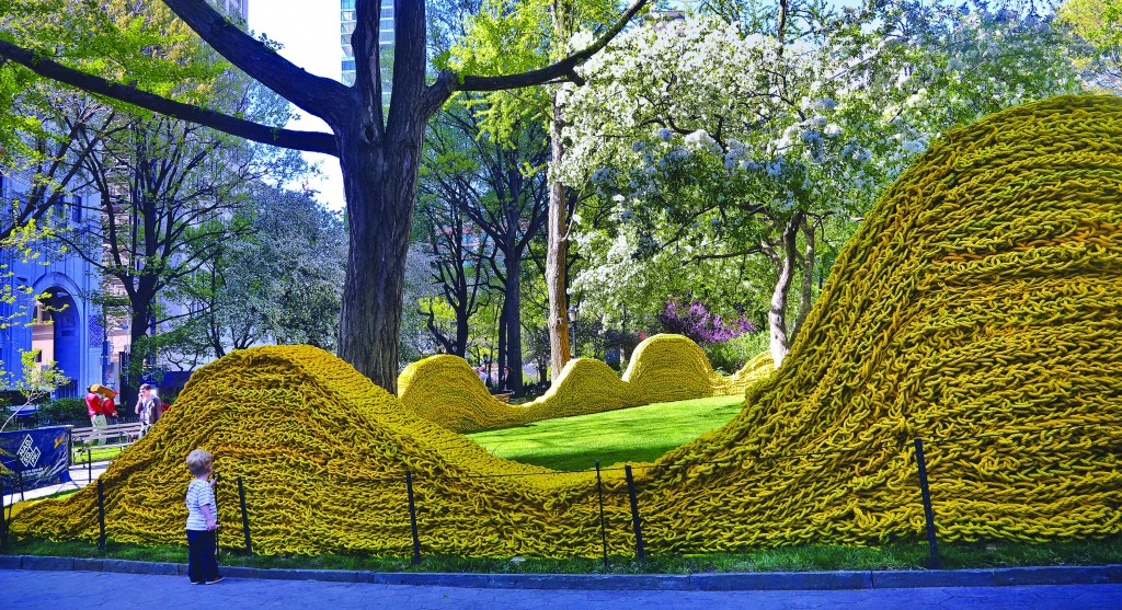 """Part of more than 1.4 million feet of painted, hand-knotted-rope by artist Orly Gender titled """"Red, Yellow and Blue,"""" is installed in Madison Square Park on Wednesday. (AP Photo/Bebeto Matthews)"""