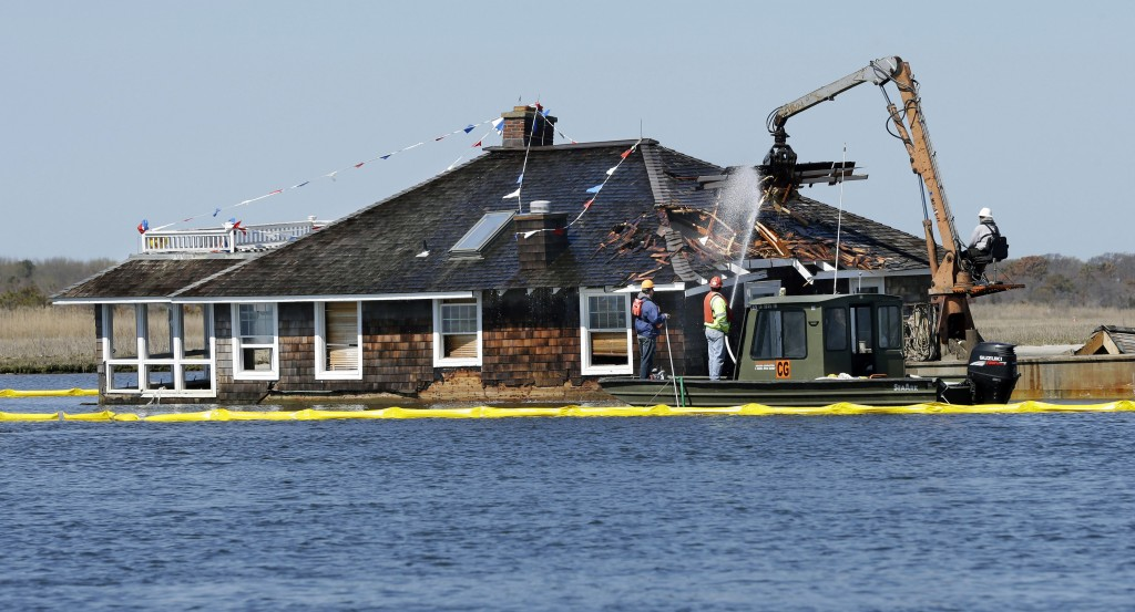 A crew starts demolition of a house that became one of the defining images of Superstorm Sandy in Mantoloking, N.J., Thursday. (AP Photo/Mel Evans)