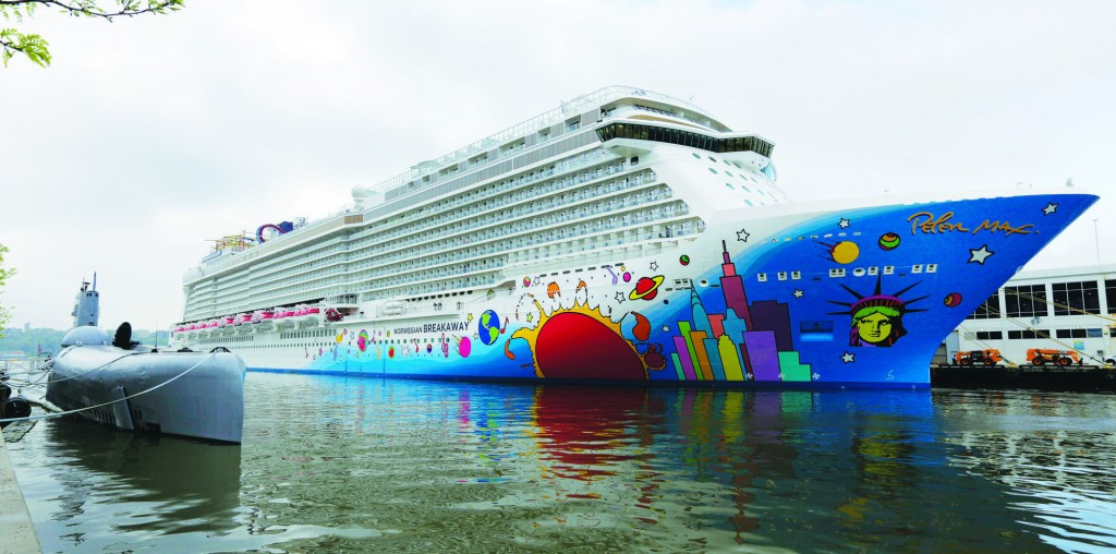 The new Norwegian Breakaway docked at the Intrepid Sea Air and Space Museum in Manhattan, Wednesday. (AP Photo/Richard Drew)