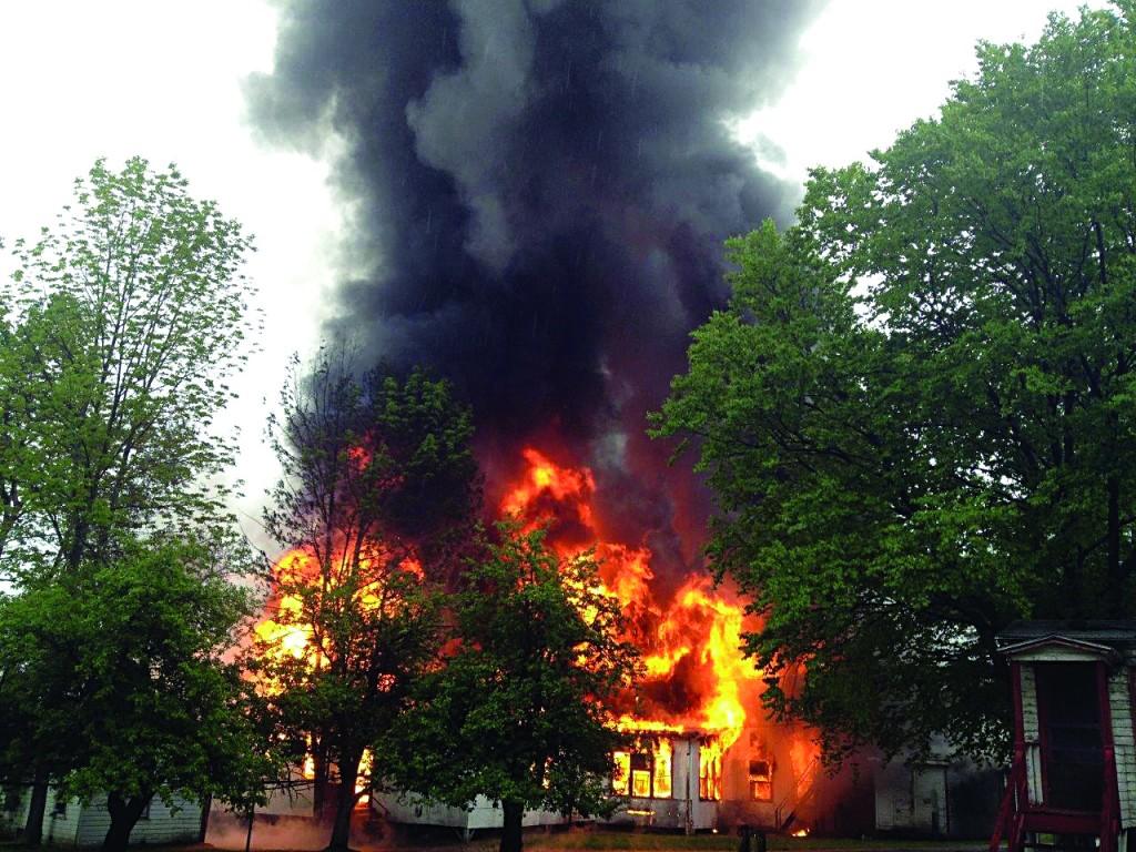 A fire roars through a building in Machne Bnos Skver in Woodridge on Tuesday.(Machne Bnos Skver)