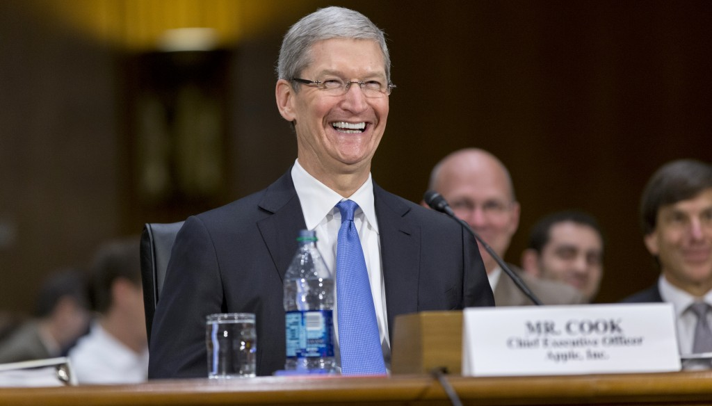 Apple CEO Tim Cook smiles as he testifies on Capitol Hill in Washington on Tuesday. (AP Photo/J. Scott Applewhite)