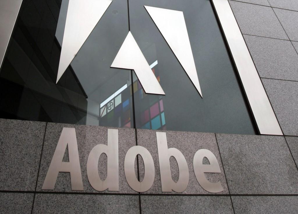 An exterior view of the Adobe headquarters is seen in San Jose, Calif. (AP Photo/Paul Sakuma, File)