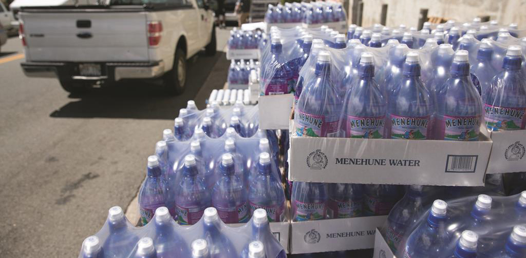 Cases of water at the Menehune Water Company, Thursday, Aug. 7, in Aiea, Hawaii. Hawaii is bracing for hurricanes Iselle and Julio. (AP Photo/Marco Garcia)