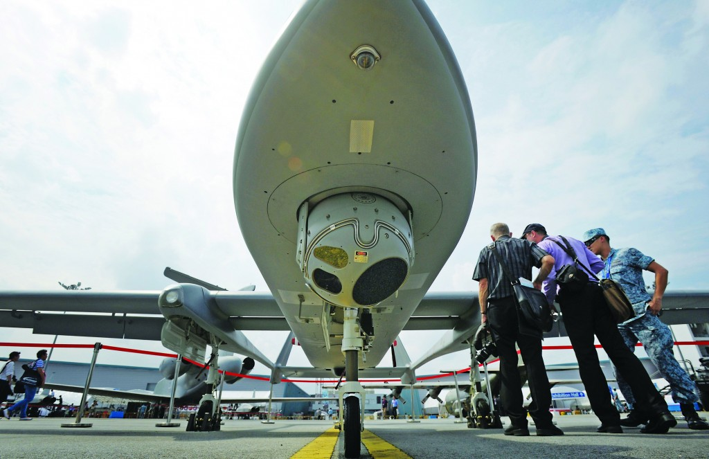 Visitors view an IAI Heron 1 Unmanned Aerial Vehicle operated by the Singapore Air Force at the Singapore Air Show this week.  (AP Photo/Joseph Nair)