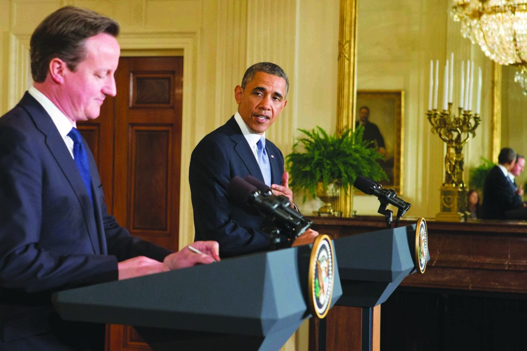 Britain's Prime Minister David Cameron (L) listens as President Obama (R) responds to a question during a joint news conference in the East Room at the White House in Washington, Monday. (AP Images)