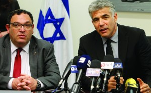 Finance Minister and Yesh Atid party leader Yair Lapid, right, with Education Minister Shai Piron.(Miriam Alster/FLASH90)