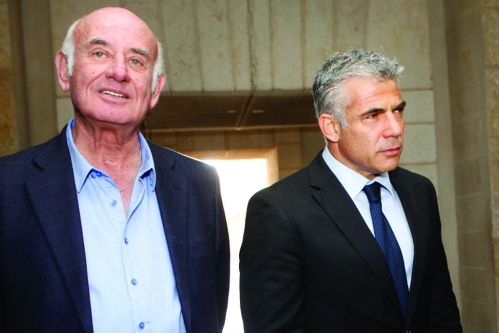 Yair Lapid (R), head of the Yesh Atid political party, and Yesh Atid party member Yaakov Perry (L). (Miriam Alster/FLASH90)