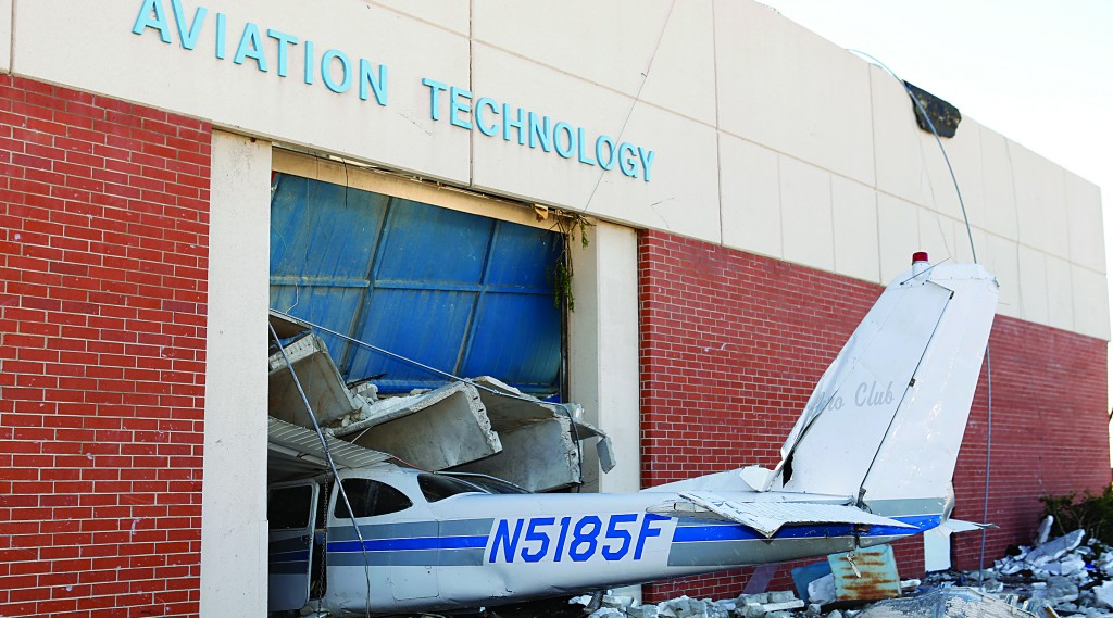 An airplane is damaged in the Aviation Technology building on the campus of the Canadian Valley Technology Center in El Reno, Okla., Sunday.