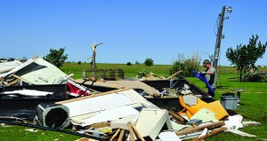 An El Reno, Okla. resident searches through the wreckage of a friend's mobile home hoping to find undamaged belongings in El Reno on Saturday. (AP Photo/Alonzo Adams)