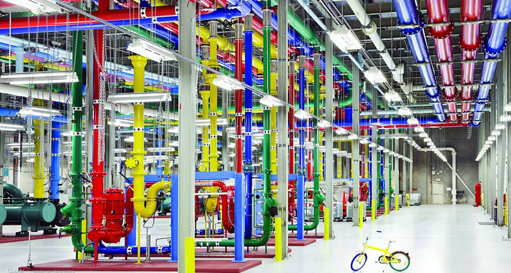 This undated photo from Google shows colorful pipes sending and receiving water to cool Google's data center in Douglass County, Ga. On the right is a G-Bike, the vehicle of choice for employees to travel around the vast center. (AP Photo/Google, Connie Zhou)