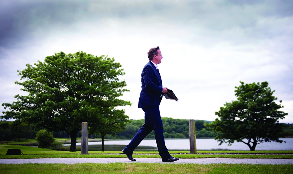 British Prime Minister David Cameron walks on his way to a news conference at the G-8 summit at the Lough Erne golf resort in Enniskillen, Northern Ireland, on Tuesday (AP Photo/Stefan Rousseau, Pool)