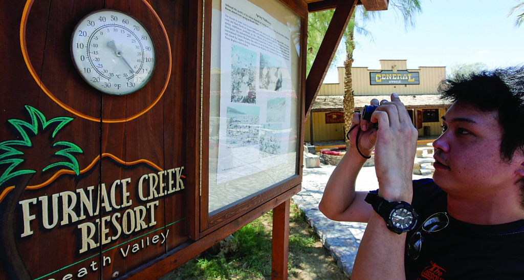 Okamura Kazuhiko of Japan takes a picture of the thermometer at the Furnace Creek resort in Death Vally National Park in Furnace Creek, Calif. (AP Photo/Chris Carlson)