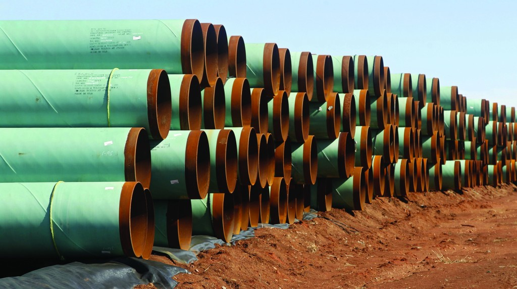 Miles of pipe ready to become part of the Keystone Pipeline are stacked in a field near Ripley, Okla. President Obama said the proposed Keystone XL pipeline project from Canada to Texas should only be approved if it doesn't worsen carbon pollution. (AP Photo/Sue Ogrocki, File)