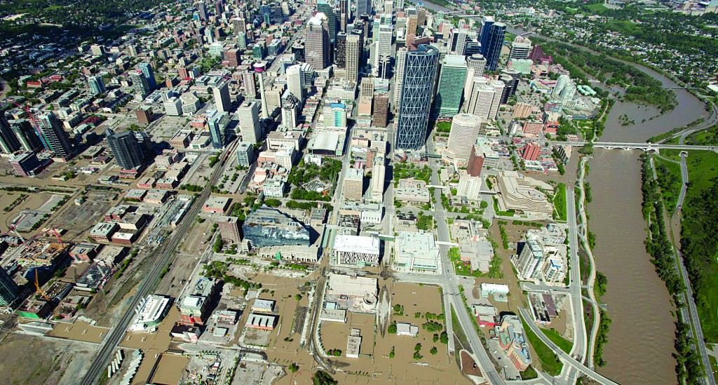 A flooded downtown Calgary, Alberta is seen from a aerial view of the city, over the weekend. (AP Photo/The Canadian Press, Jonathan Hayward)