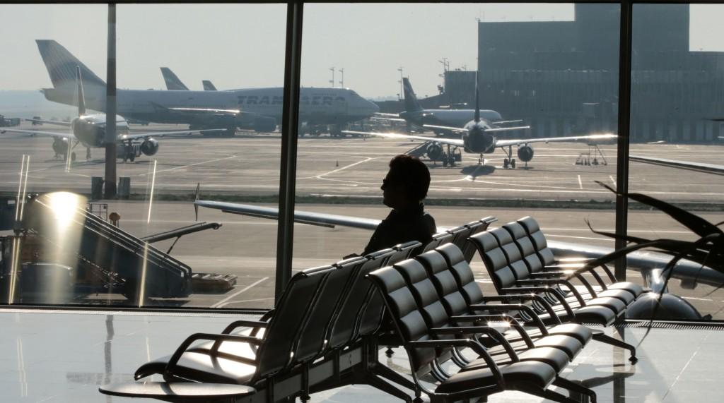 A passenger waits for his flight at Moscow's Sheremetyevo airport Wednesday. (REUTERS/Tatyana Makeyeva)