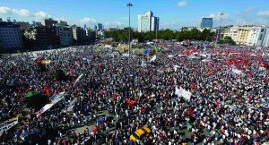 Anti-government protesters gather in Istanbul's Taksim square Sunday. (REUTERS/Yannis Behrakis)
