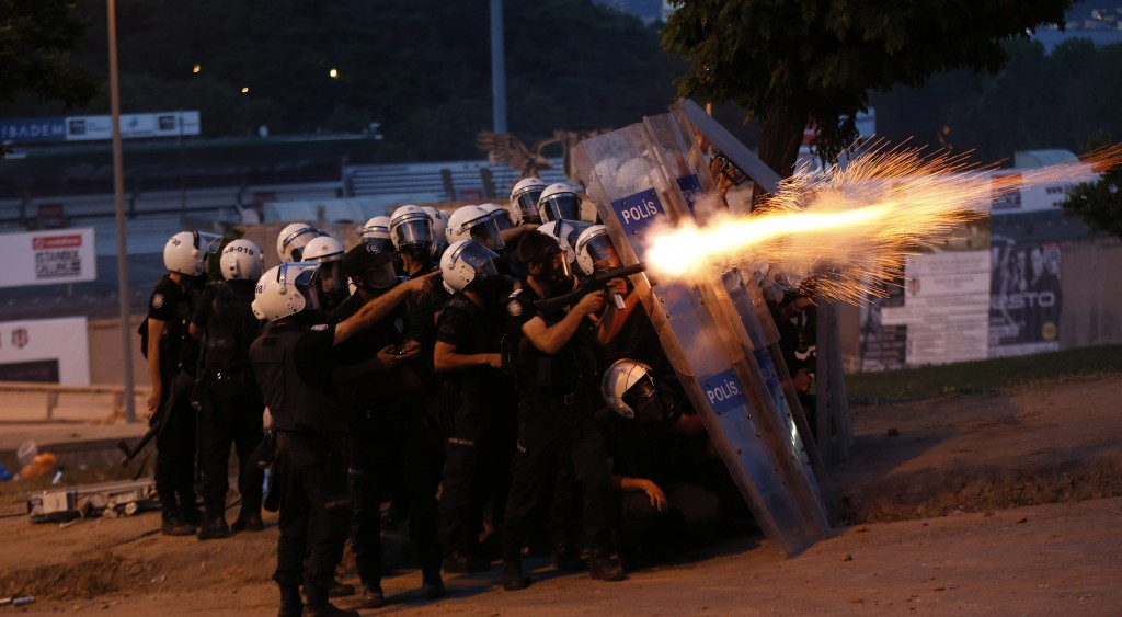 Riot police use tear gas to disperse the crowd during an anti-government protest in Istanbul Monday. (REUTERS/Murad Sezer)