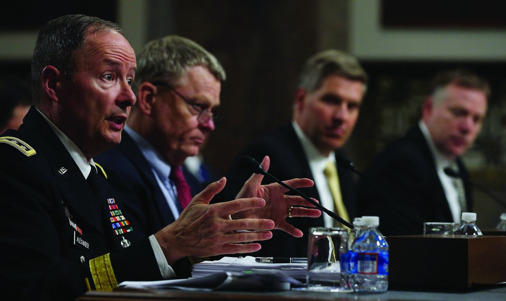 (L-R), U.S. Army Gen. Keith Alexander, commander of the U.S. Cyber Command and director of the National Security Agency (NSA) testifies, flanked by Rand Beers, Acting Deputy Homeland Security Secretary; Patrick Gallagher, Acting Deputy Commerce Secretary, director of the National Institute of Standards and Technology; and Richard McFeely, executive assistant director of the Federal Bureau of Investigation's Criminal, Cyber, Response, and Services Branch, at Senate Appropriations Committee hearing on Capitol Hill, June 12, in Washington, DC. (Mark Wilson/Getty Images)